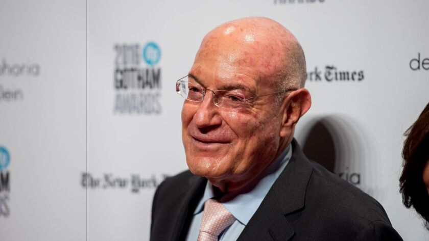 Arnon Milchan is accused of giving thousands of dollars worth of cigars and champagne to Israel's prime minister and his wife.