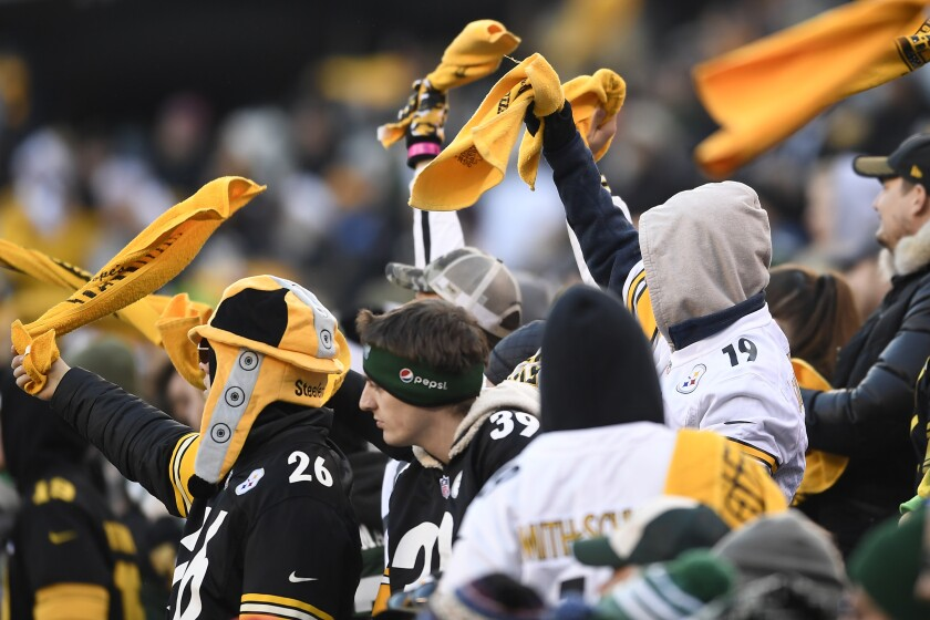 Pittsburgh Steelers fans wave Terrible Towels during the second half of a game against the New York Jets on Sunday at MetLife Stadium.