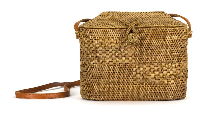 The Marfa Bag by Bembien is a classic basket bag with elegant, thoughtful details, including multipl