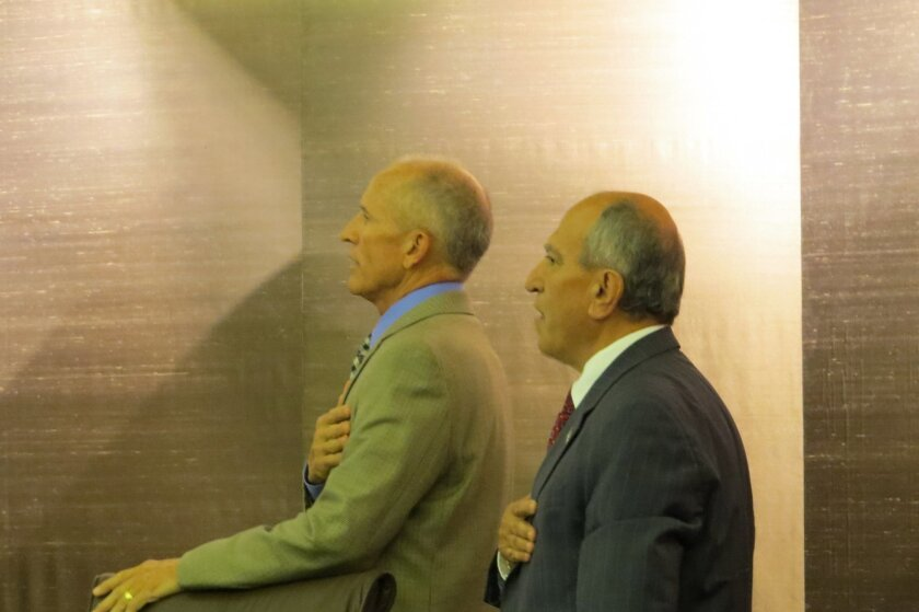 Councilman Mike Morasco (left) and Mayor Sam Abed during the Pledge of Allegiance just prior to the announcement.