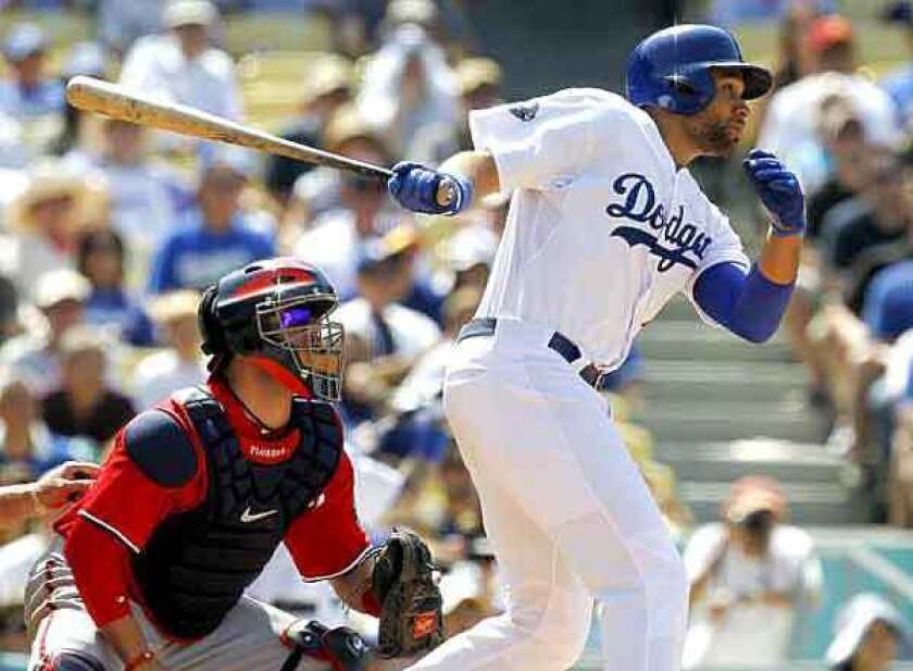 Dodgers first baseman watches his two-run single head toward center field as he follows through on his swing in the sixth inning Sunday against the Nationals.