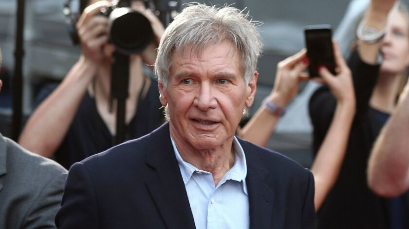 In this December 10, 2015 file photo, Harrison Ford greets fans during a Star Wars fan event in Sydney, Australia. (Rob Griffith / Associated Press)