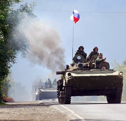 Russian peacekeeping soldiers drive military vehicles out of the Kventakosa checkpoint. Russia and the EU took a key step toward resuming partnership talks after President Dmitry Medvedev pledged his troops would complete their pullout from buffer zones in Georgia.