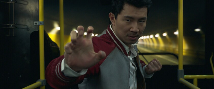 """Simu Liu strikes a fighting pose in """"Shang-Chi and the Legend of the Ten Rings"""""""