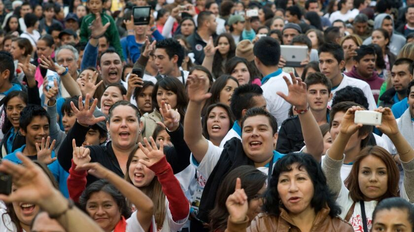 A crowd cheers during a practice for the Pa' Bailar massive dance event during the closing event on the last day of Tijuana Innovadora 2012.