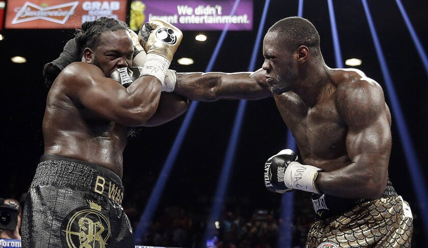 Deontay Wilder lands a punch against Bermane Stiverne during their WBC heavyweight championship bout on Saturday night at the MGM Grand Garden Arena in Las Vegas.