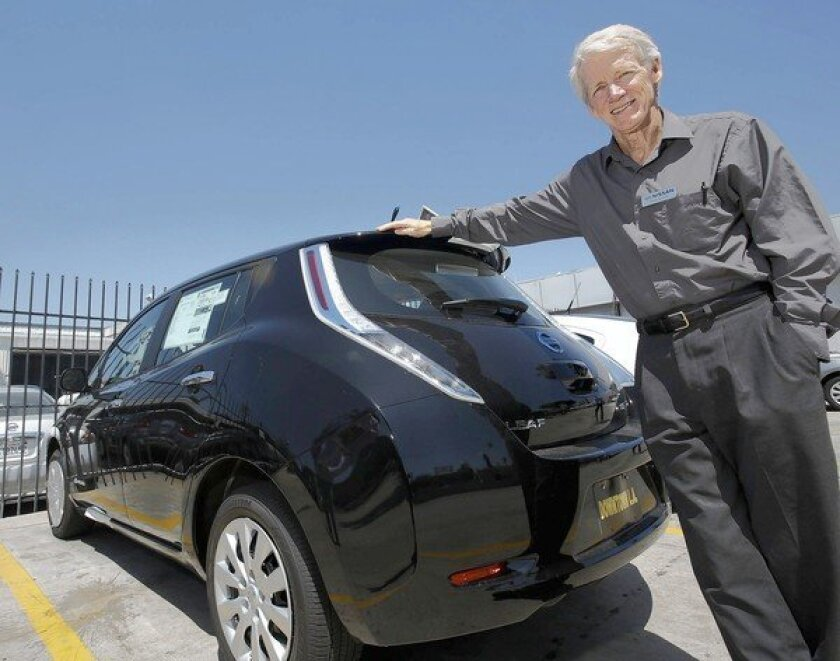 Paul Scott is shown at the dealership where he sells Nissan Leafs, an electric-powered car. He got an invitation to a Democratic fundraiser in Santa Monica and wanted a chance to tell President Obama about the virtues of electric vehicles. But the DNC, insinuating that he was merely seeking media attention, rescinded his invitation and returned his large donation.