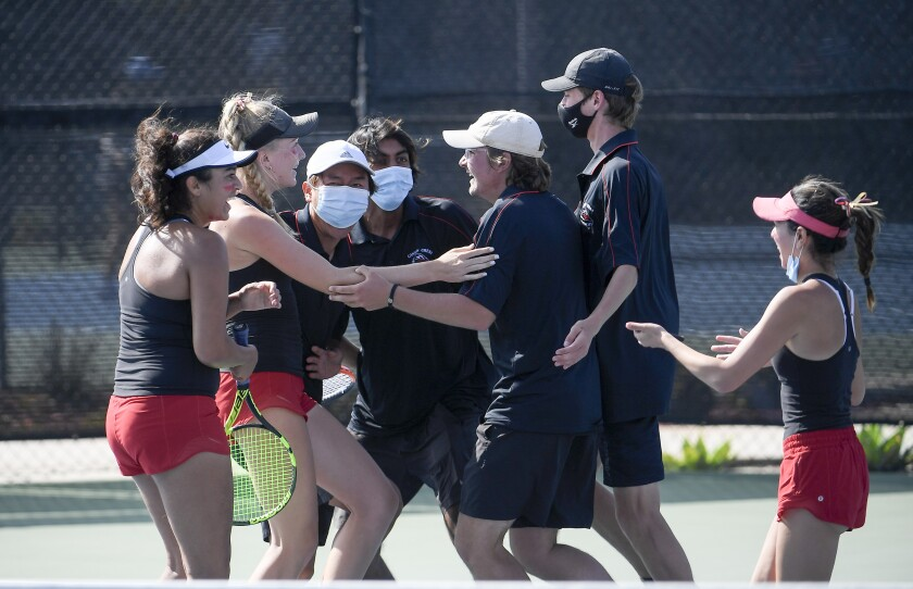 Canyon Crest players celebrate after beating Torrey Pines in the coed tennis Open Division championship on Thursday.