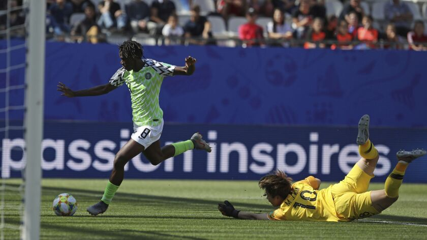 Nigeria's Asisat Oshoala takes the ball around South Korea goalkeeper Kim Min-jung on her way to sco
