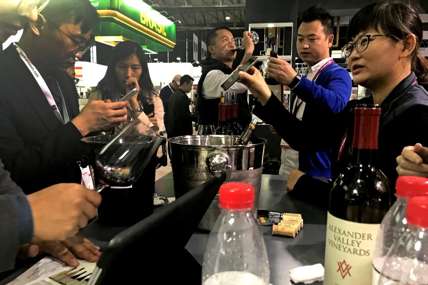 In Shanghai, customers gather at the Alexander Valley Vineyards booth at the 2018 ProWine trade show.