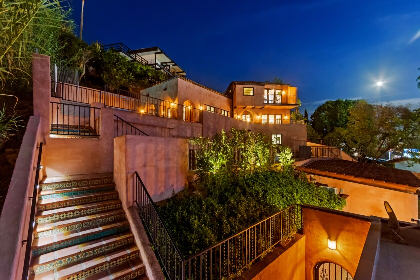 The renovated haunt of early Hollywood star Errol Flynn is available for lease above the Sunset Strip for $25,000 a month. The Spanish-style house, which comes fully furnished, overlooks the Comedy Store from its perch in the Hollywood Hills. A recent remodel has introduced a range of modern updates to the 3,084-square-foot house, which has five bedrooms and five bathrooms. Wide-plank wood floors and colorful tile risers are among features of the house. Various patios and balconies create additional living spce outdoors.
