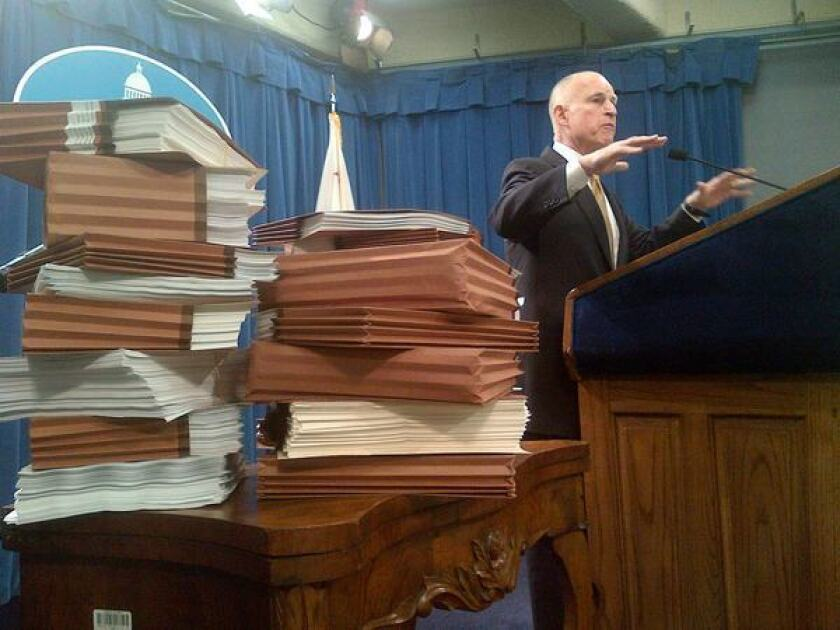 Gov. Jerry Brown, shown here in January pledging to appeal prison crowding caps before the U.S. Supreme Court, says he is optimistic about negotiations between the state and lawyers for inmates.