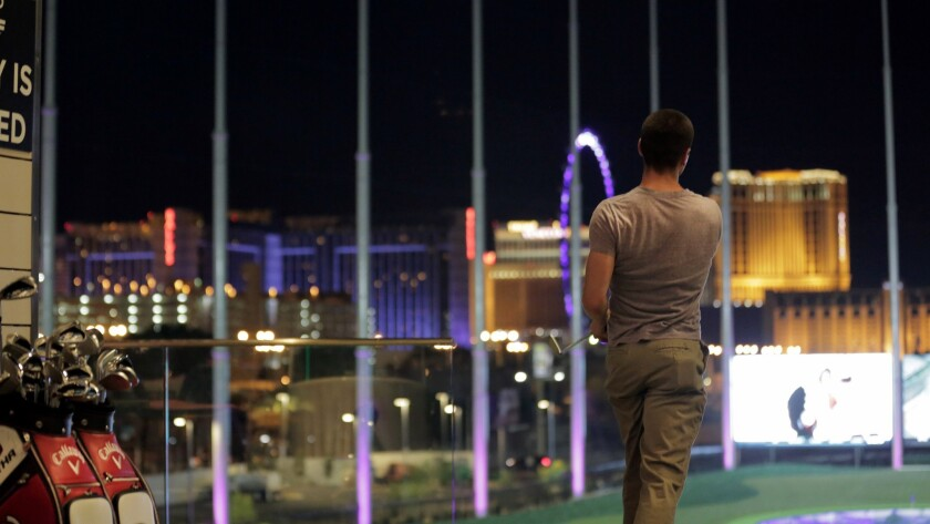 You can see the lights of Las Vegas during a late-night game at Topgolf, a new sporting attraction just off the Strip.