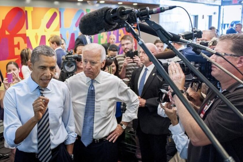 President Obama and Vice President Biden talk to the media outside a restaurant after walking from the White House for lunch.