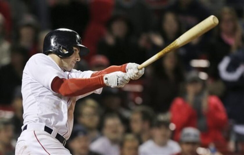 Boston Red Sox' Stephen Drew follows through on his game-winning, RBI double in the eleventh inning of a baseball game against the Minnesota Twins at Fenway Park in Boston, Monday, May 6, 2013. The Red Sox won 6-5. (AP Photo/Charles Krupa)