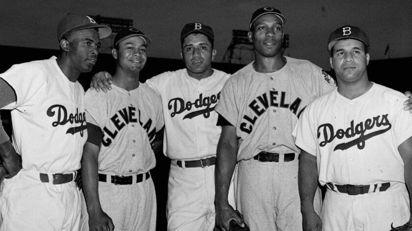 From left, Jackie Robinson, Larry Doby, Don Newcombe, Luke Easter and Roy Campanella pose at Ebbets Field in 1950.
