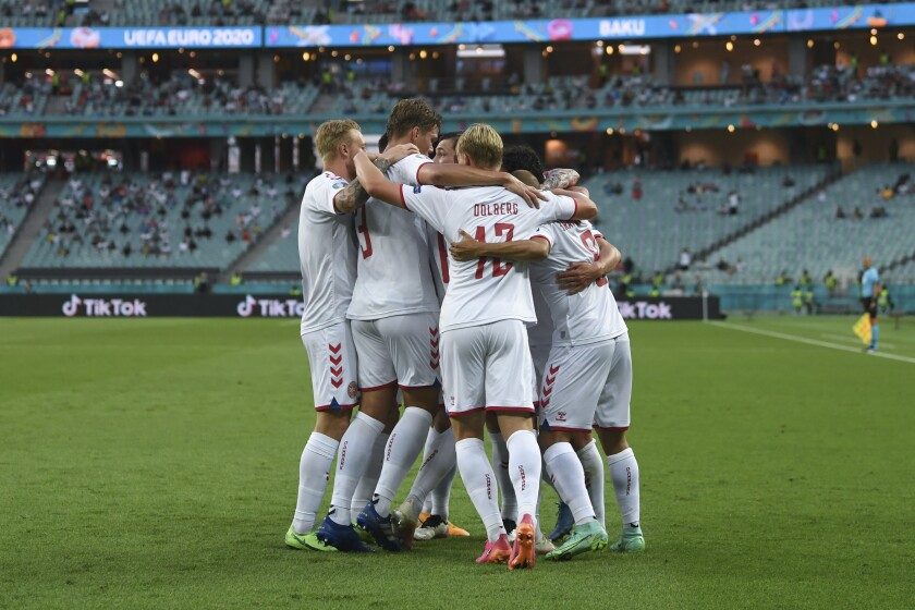 Denmark's Thomas Delaney celebrates with teammates after scoring his side's opening goal during the Euro 2020 soccer championship quarterfinal match between Czech Republic and Denmark, at the Olympic stadium in Baku, Saturday, July 3, 2021. (Ozan Kose, Pool via AP)