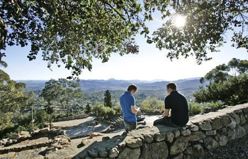 El Cajon Valley High students Eddie Maranhao, 17, (left) and James Henry, 17, enjoy a panoramic view of the San Diego area. (Nancee E. Lewis / Union-Tribune)