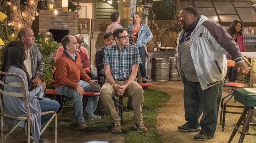 """Nelson Franklin, center, as new partner Bill and Leonard Ouzts as bouncer James in """"Abby's,"""" a new NBC sitcom."""