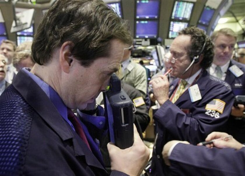 FILE - In this Dec. 4, 2009 file photo, Traders work on the floor of the New York Stock Exchange. Stock futures are indicating a higher open on Wall Street Wednesday, Dec. 9, 2009, bouncing back from the previous day's losses as the dollar resumes its decline. (AP Photo/Richard Drew, file)