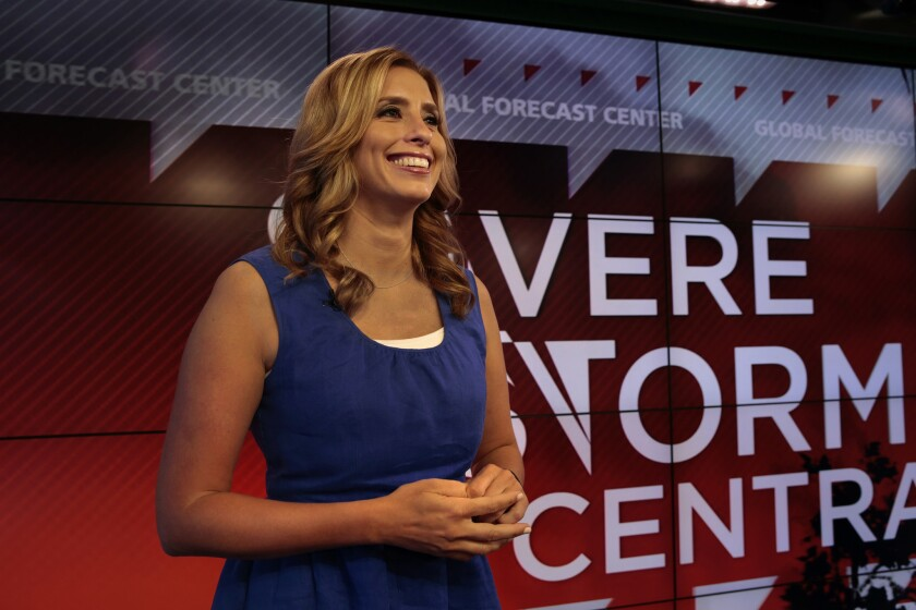 Stephanie Abrams, a correspondent for the Weather Channel, is pictured in 2013. The network will no longer be seen on Verizon FiOS.