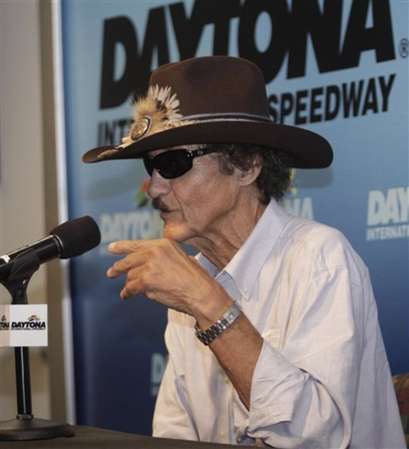 Team owner and former driver Richard Petty answers questions during a news conference at Daytona International Speedway in Daytona Beach, Fla., Friday, July 3, 2009. (AP Photo/Terry Renna)