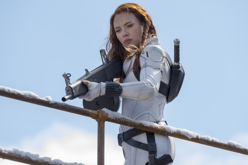 """This image released by Marvel Studios shows Scarlett Johansson in a scene from """"Black Widow."""" (Jay Maidment/Marvel Studios-Disney via AP)"""