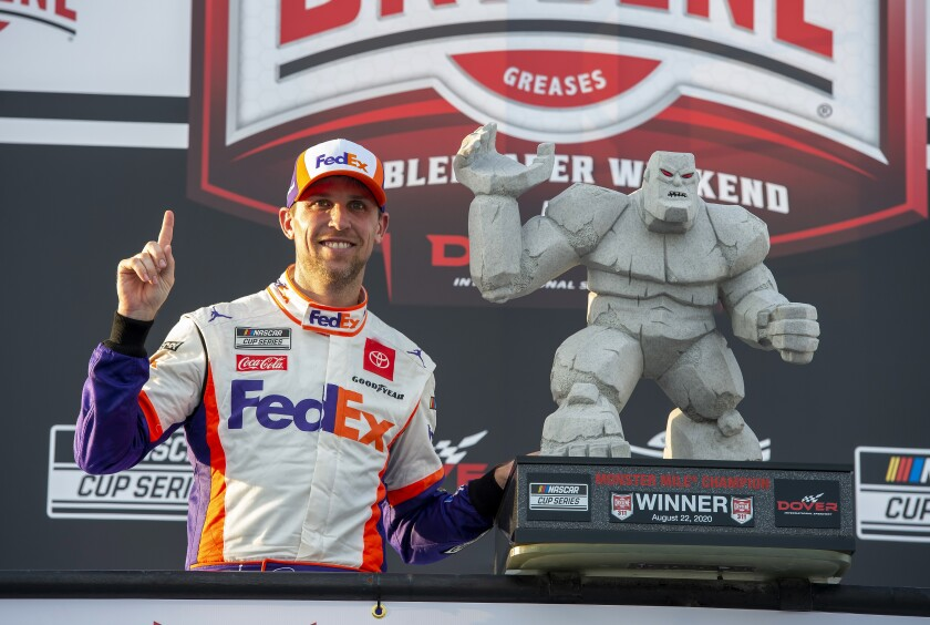 Denny Hamlin celebrates after winning the NASCAR Cup Series race at Dover International Speedway on Aug. 22, 2020.