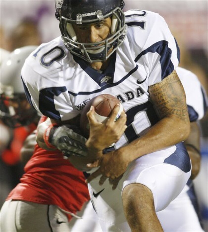 Nevada quarterback Colin Kaepernick (10) carries the ball against UNLV during the first half of an NCAA college football game Saturday, Oct. 2, 2010, in Las Vegas. (AP Photo/Isaac Brekken)