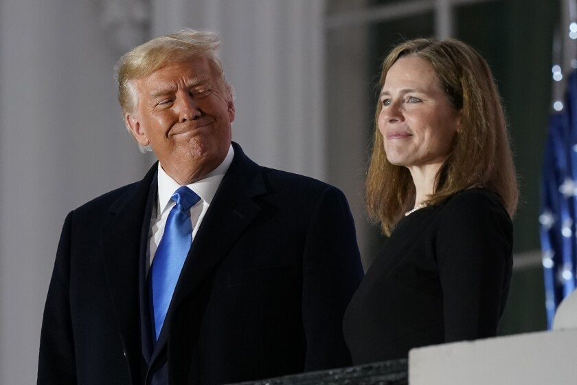 President Trump and Amy Coney Barrett stand outside the White House.