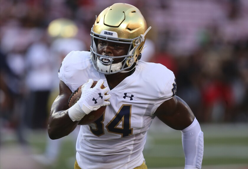 FILE - Notre Dame Jahmir Smith runs during an NCAA football game on Monday, Sept. 2 , 2019, in Louisville, Ky. With all the success Notre Dame has enjoyed its last three seasons, amassing a 33-6 record under coach Brian Kelly, it has been the inability to run the football successfully in big games that has curtailed the championship hopes of the Fighting Irish. No. 10 Notre Dame hopes to change that starting Saturday when Duke visits for the 2020 season opener. (AP Photo/Tony Tribble, File)