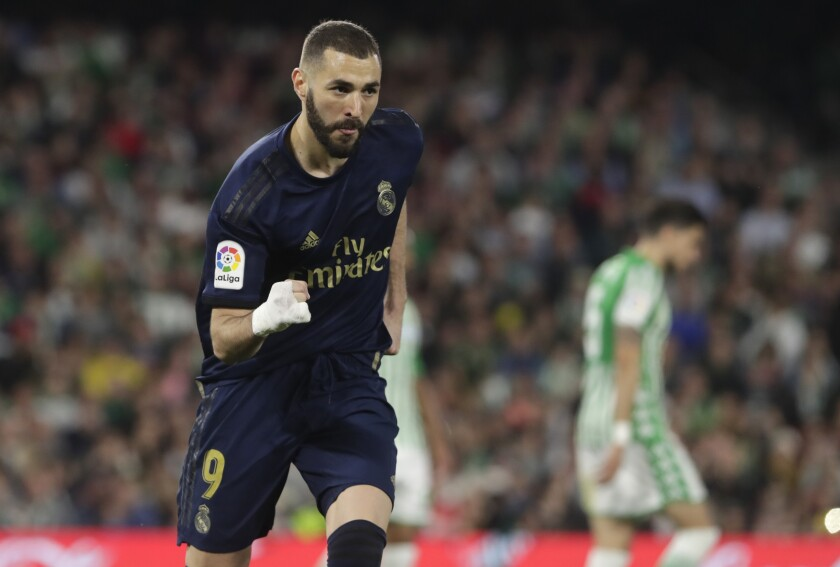 Real Madrid's Karim Benzema celebrates scoring his side's first goal during La Liga soccer match between Betis and Real Madrid at the Benito Villamarin stadium in Seville, Spain, Sunday, March. 8, 2020. (AP Photo/Miguel Morenatti)