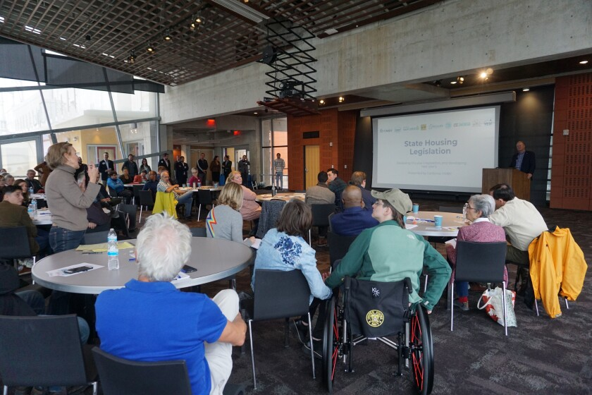 "Mission Hills resident Sharon Gehl joined dozens of housing advocates and elected officials Saturday to discuss housing priorities for the upcoming state legislative session. The ""YIMBY Legislative Town Hall"" was held at the San Diego Central Library."