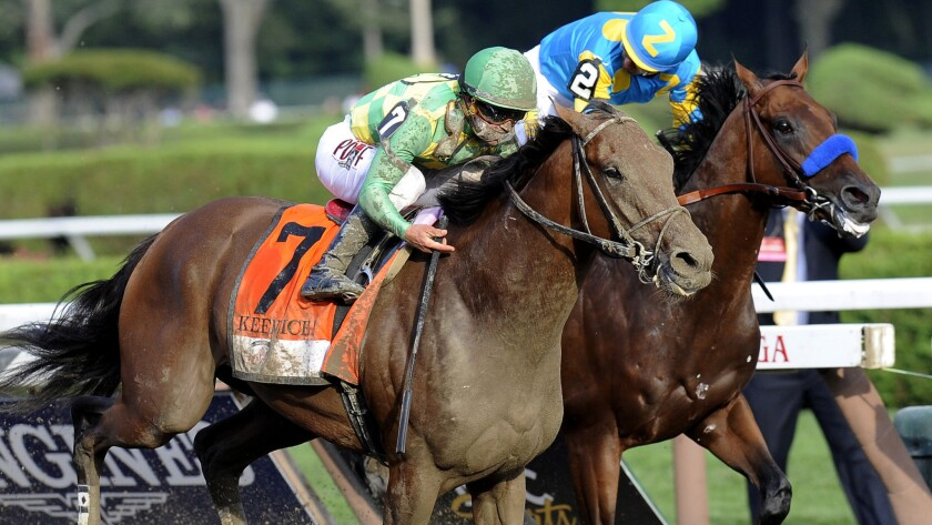 Keen Ice (7), with Javier Castellano aboard, moves past Triple Crown winner American Pharoah and jockey Victor Espinoza to win the Travers Stakes on Saturday at Saratoga Race Course.