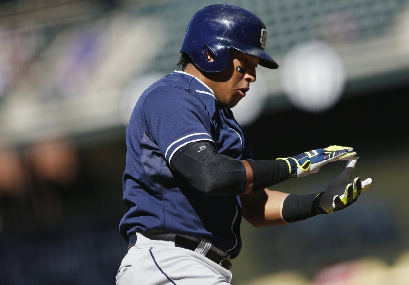San Diego Padres' Yangervis Solarte celebrates as he crosses home plate after hitting a two-run home run off Colorado Rockies starting pitcher Kyle Kendrick in the first inning of a baseball game Sunday, Sept. 20, 2015, in Denver. (AP Photo/David Zalubowski)