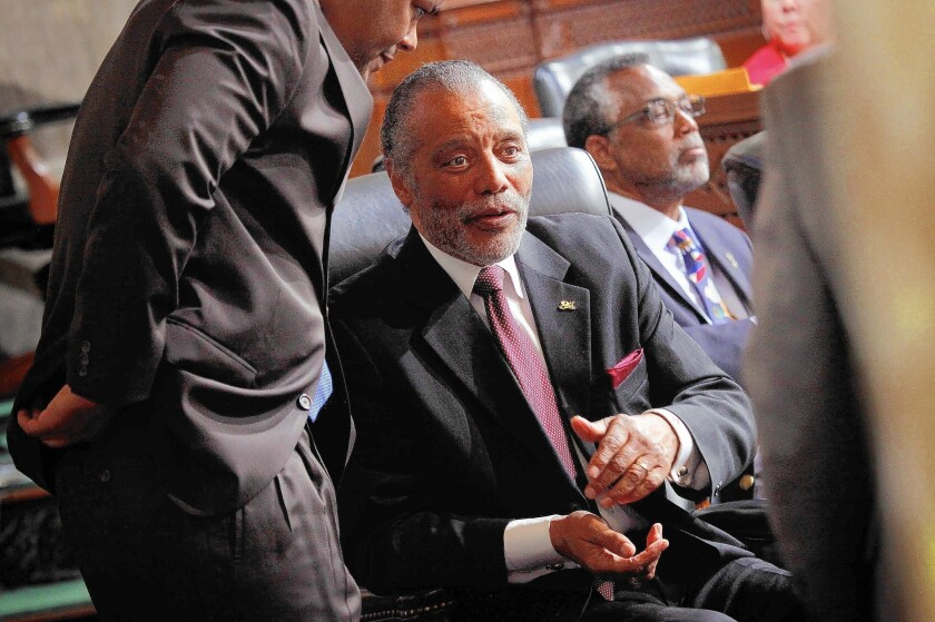 Los Angeles City Councilman Bernard C. Parks speaks to a colleague before a vote at City Hall in 2013. Once seen as politically untouchable, the longtime South L.A. lawmaker is a diminished figure in the view of both critics and some admirers.