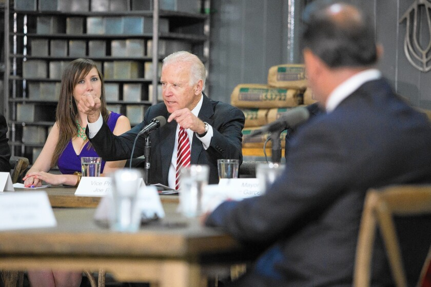 Vice President Joe Biden, center, addresses a roundtable discussion in Lincoln Heights on Tuesday; earlier, Biden praised Mayor Eric Garcetti's plan to raise the minimum wage.