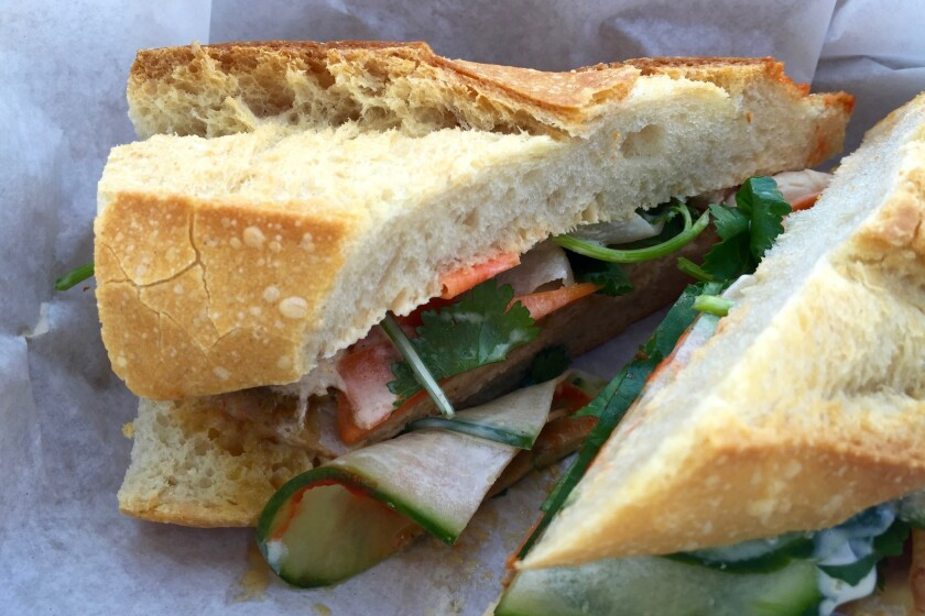 The Steve Julian sandwich, Wax Paper's take on the banh mi, stuffed with roasted pork loin, pickled carrots and daikon and a miso and bacon fat aioli, served on a baguette.