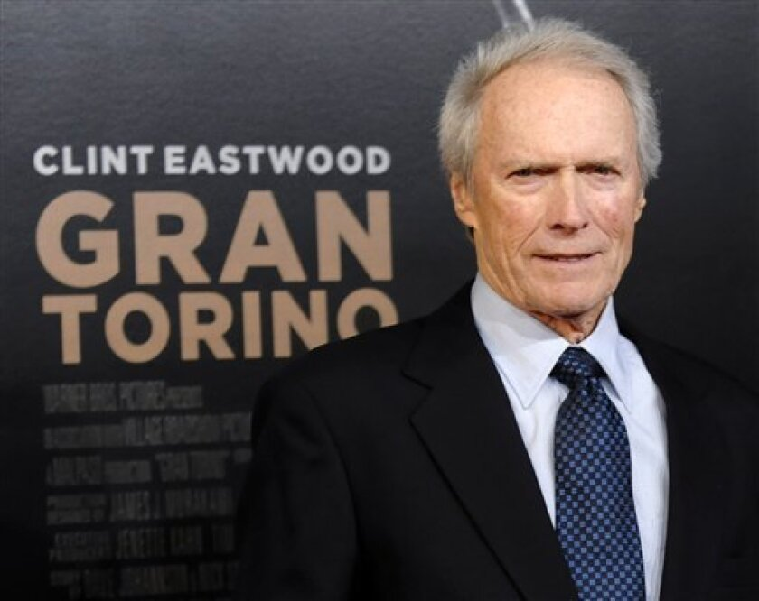 "Clint Eastwood, director and star of ""Gran Turino,"" arrives at the premiere of the film at Warner Bros. Studios in Burbank, Calif., Tuesday, Dec. 9, 2008. (AP Photo/Chris Pizzello)"