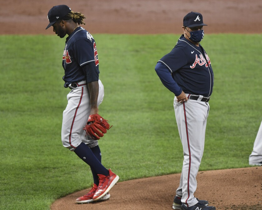 Atlanta Braves starting pitcher Touki Toussaint (62) is removed by manager Brian Snitker (43) during the third inning of a baseball game against the Baltimore Orioles, Monday, Sept. 14, 2020, in Baltimore. (AP Photo/Terrance Williams)