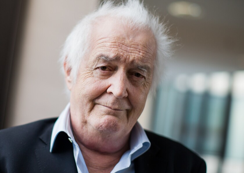 Swedish author Henning Mankell, who helped define Swedish crime literature, has died at 67. (Rolf Vennenbernd/dpa via AP)