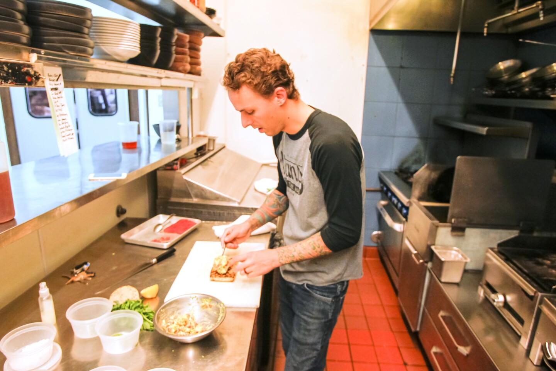 Chef William Eick of 608 Restaurant prepares his Salmon Tartare on Toast dish.