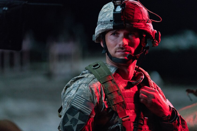 "This image released by Screen Media shows Scott Eastwood in a scene from ""The Outpost."" The film tells the story of the heroic Battle of Kamdesh in Afghanistan in 2009, where the Taliban attacked a remote American Combat Outpost that was nearly impossible to defend. (Screen Media via AP)"