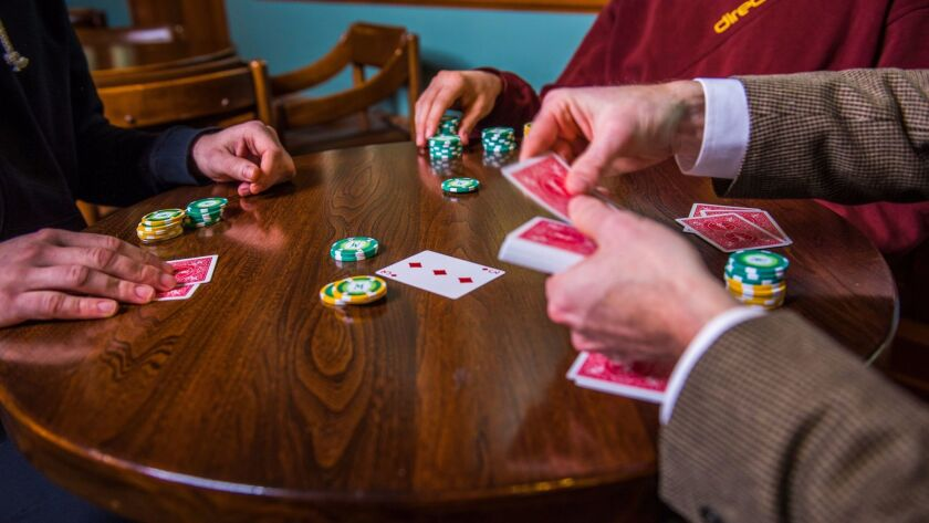 Team members from the University of Alberta computer science department and the Computer Poker Research Group play a hand of poker.