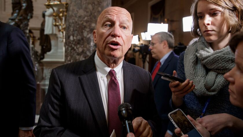 Rep. Kevin Brady (R-Texas), chairman of the tax-writing House Ways and Means Committee, talks to reporters on Capitol Hill on Thursday.