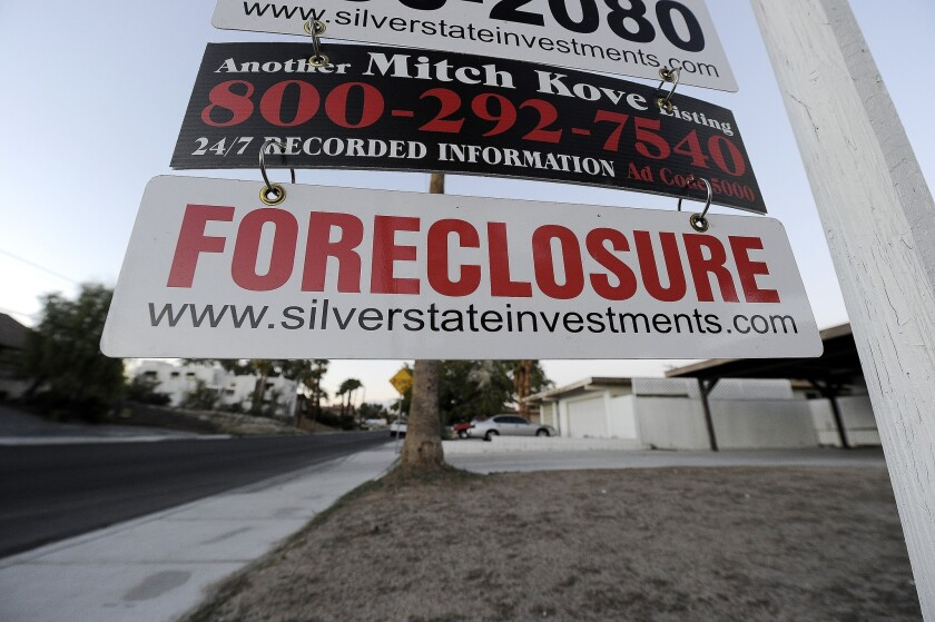 A foreclosure sign is seen in front of a bank-owned home for sale in Las Vegas in 2010.