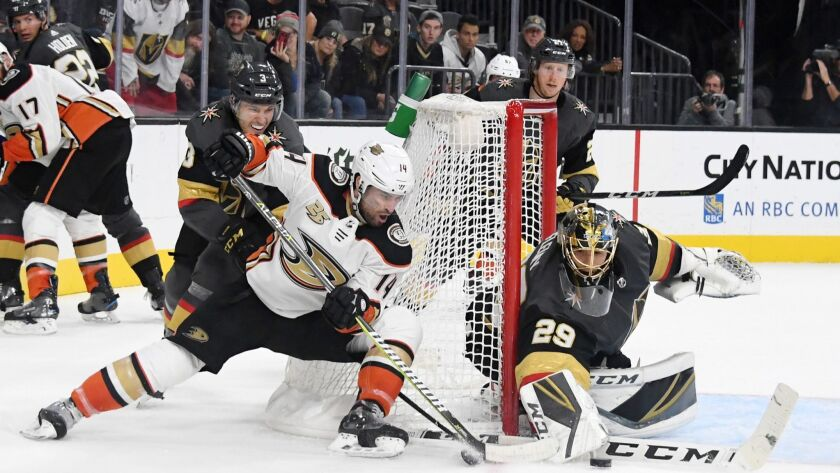 Marc-Andre Fleury (29) of the Vegas Golden Knights blocks a shot by Adam Henrique (14) of the Anaheim Ducks in the third period.