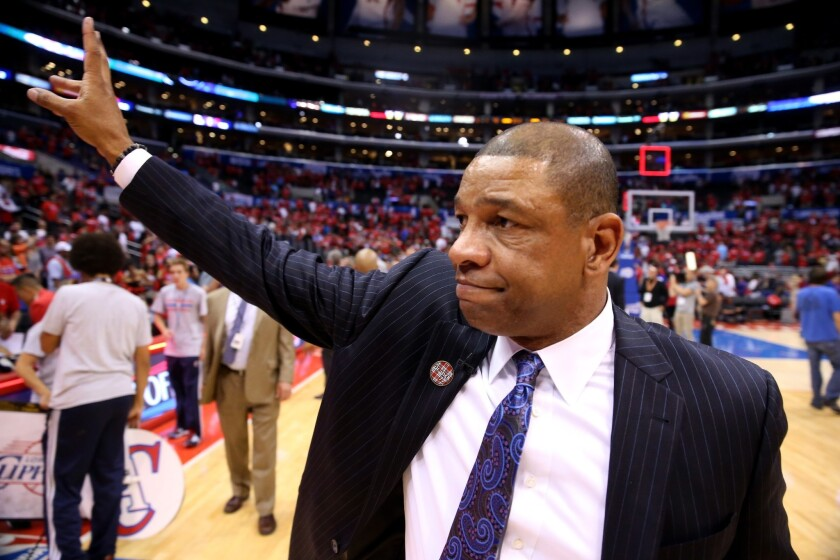 Clippers Coach Doc Rivers, who also had been senior vice president of basketball operations, will now serve as president of basketball operations in a staff restructuring announced Monday.