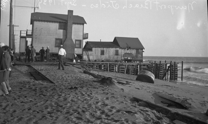 Beach houses threatened by high tides in Newport Beach.