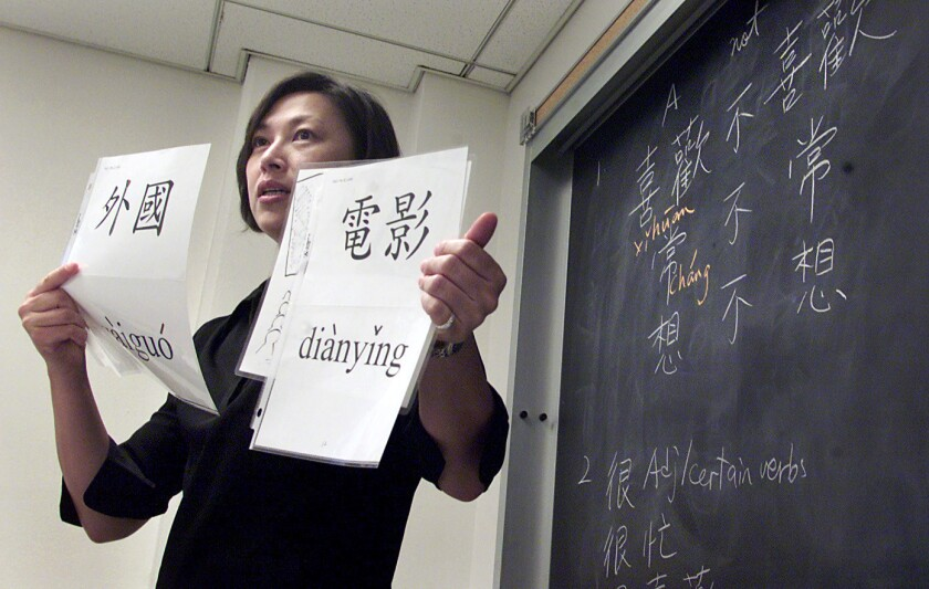 Zoe Wu reviews Chinese pronunciations with her class at USC as part of the Explore East Asia program.